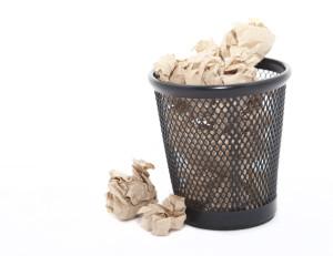 Waste paper in a bin